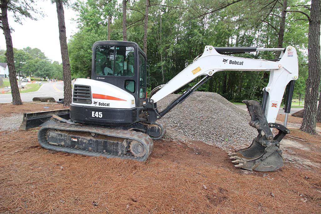 Excavator, Brooks Hauling, Grading & Landscaping, LLC
