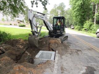 Brooks Hauling Grading & Landscaping LLC Installing Road Drainage System