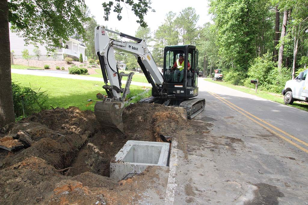 Brooks Hauling Grading & Landscaping LLC Installing Road Drainage System